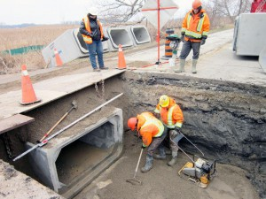 Employees of the Belmont construction firm Gary D. Robinson Contracting intend to install five more wildlife-friendly ecopassages on the Long Point Causeway before winter arrives to stay. This was the scene in the middle of the 3.6-kilometre connecting road between Port Rowan and Long Point on Wednesday. (MONTE SONNENBERG Simcoe Reformer)